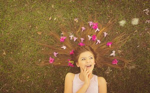 Girl with flowwers laying in the grass